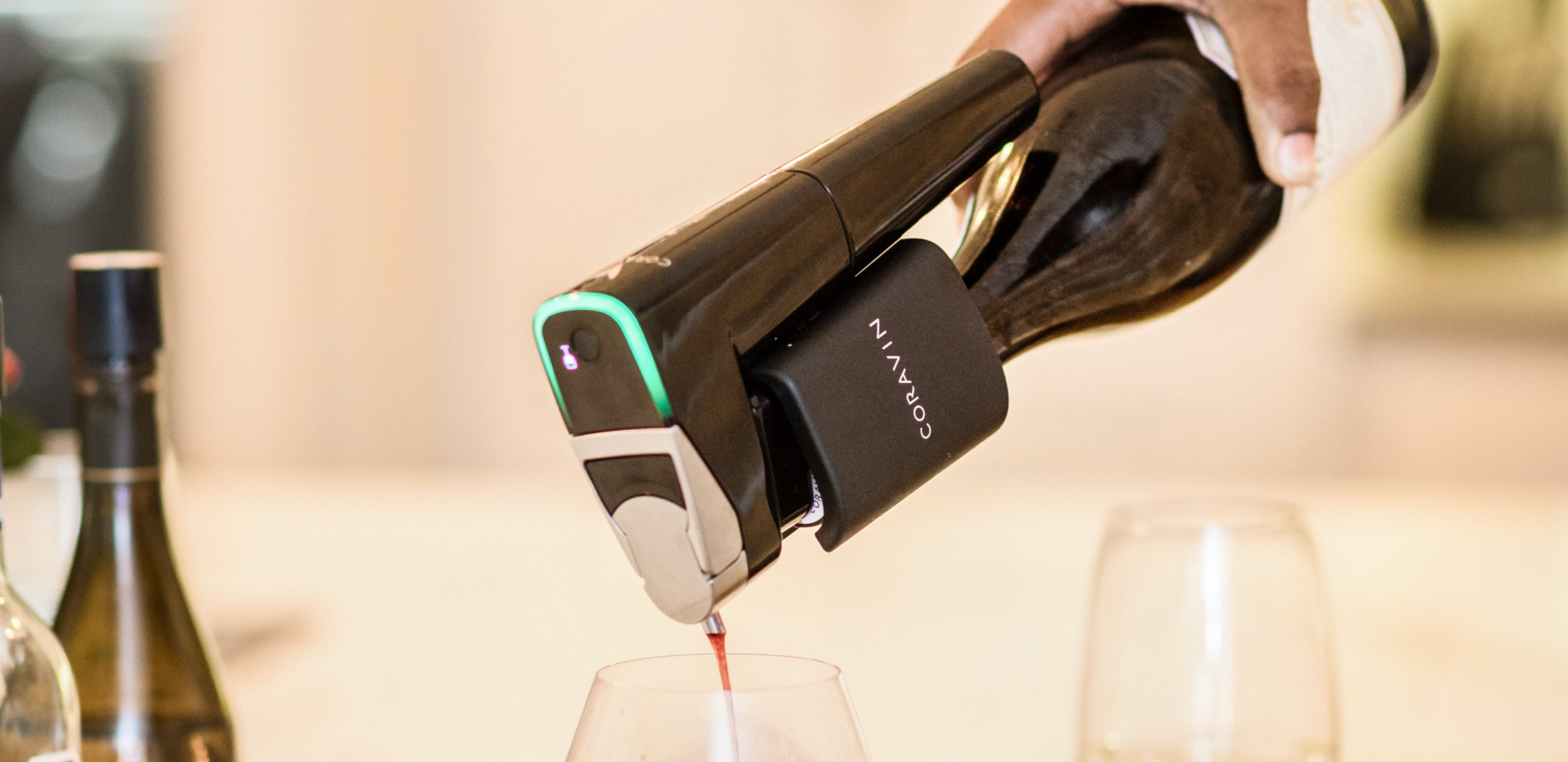 Man pouring wine with Coravin products