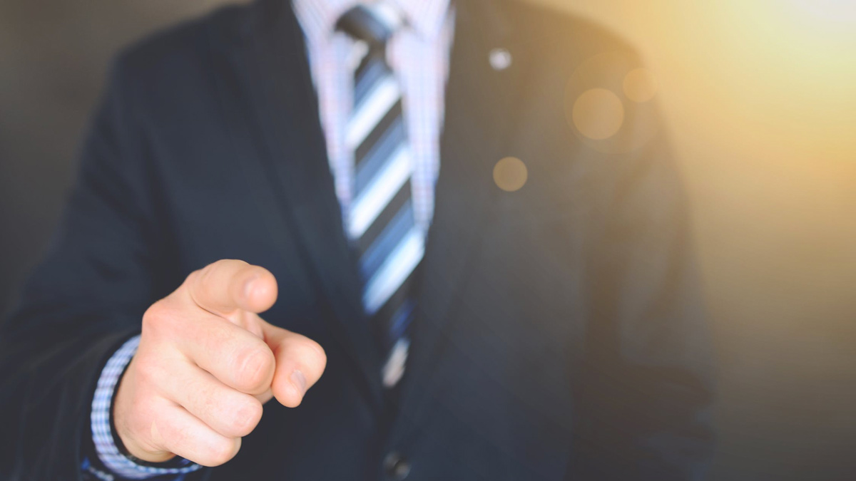 Cropped image of corporate banker, pointing finger