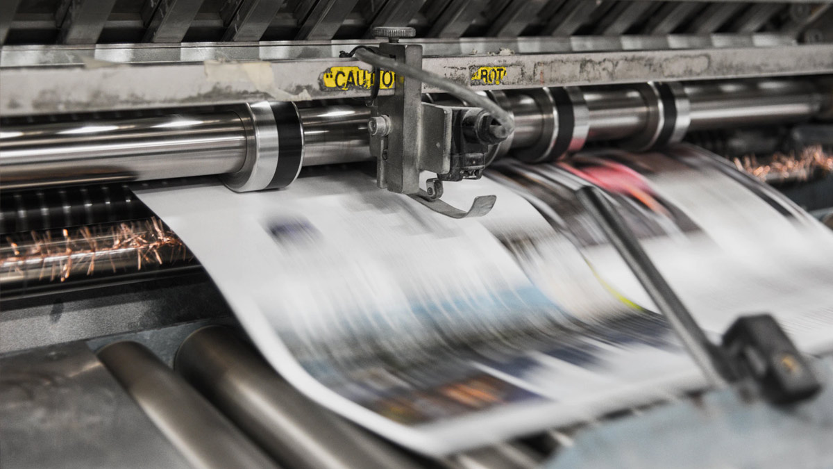 Newspapers being printed on commercial printer