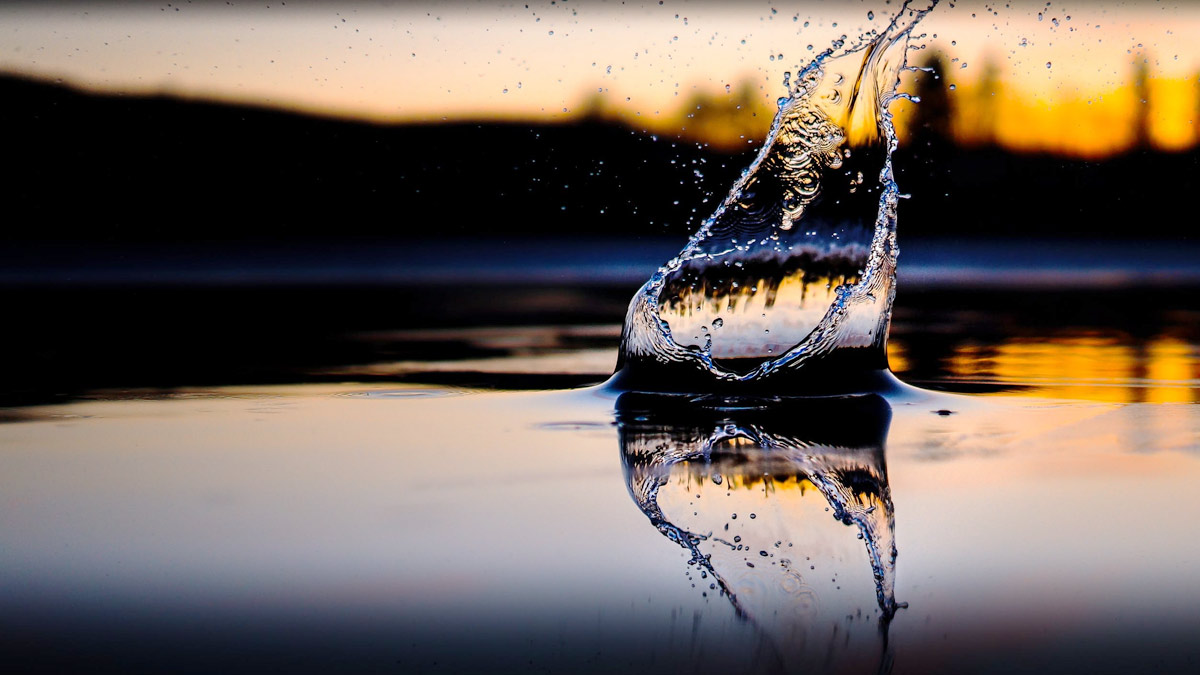 Water dropping in front of sunset