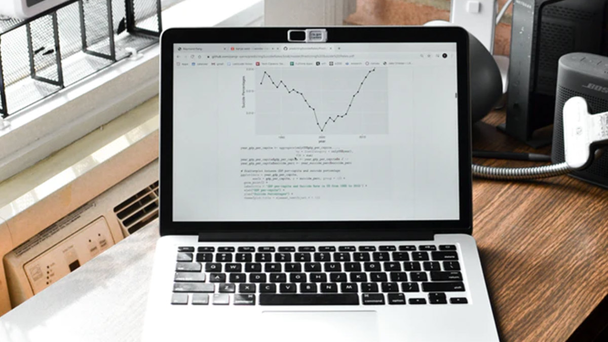 Laptop on home office desk with graph on screen