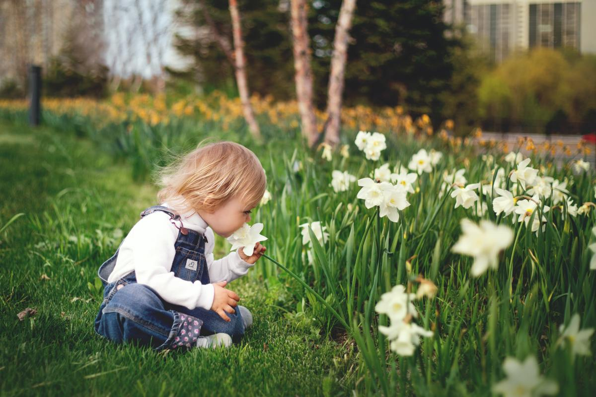 Kid smelling the flowers