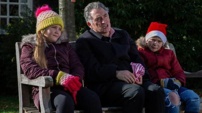 Bob and the twins outside - Emmerdale - ITV