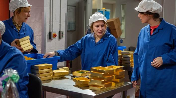 Laurel, Dawn and Kerry in the factory - Emmerdale - ITV