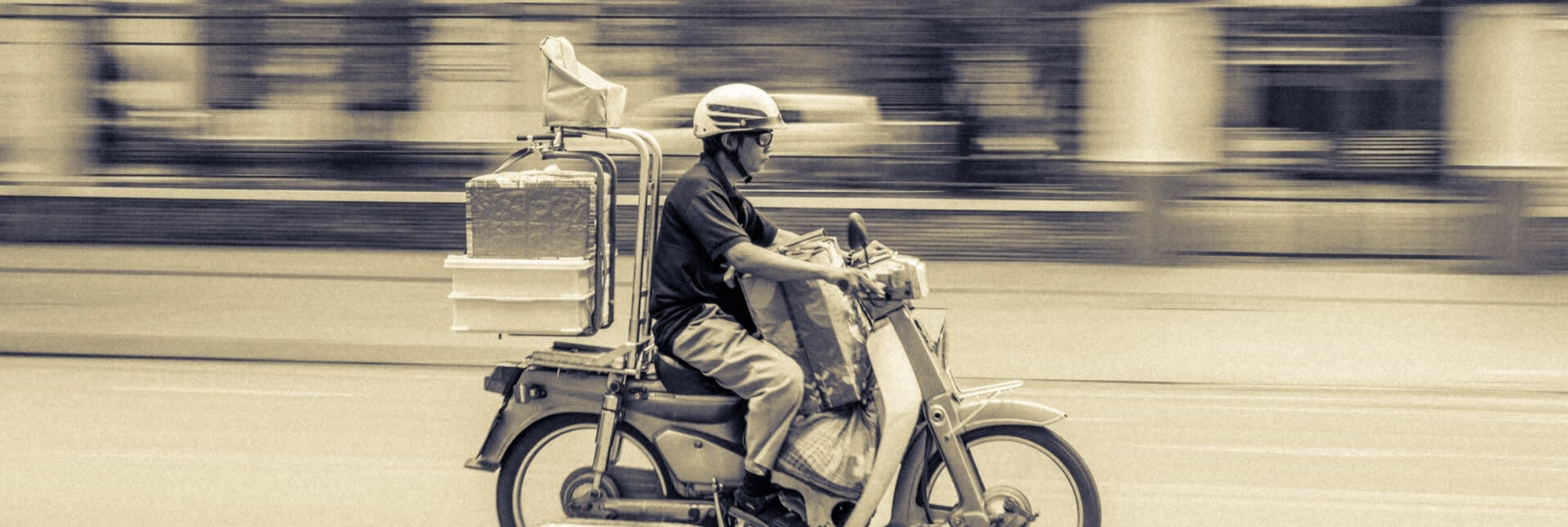 An image of someone delivering food on their motorcycle.