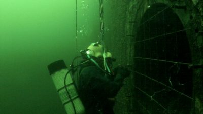 ROV Monitoring Salvage Diver at Hydro Dam. Demonstrates how ROVs can be a great way to monitor underwater construction.