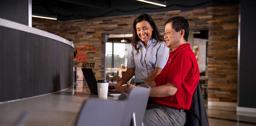 two people collaborating in cafeteria