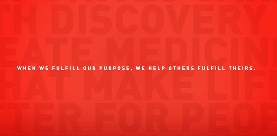 """when we fulfill our purpose, we help others fulfill theirs"" in white letters on a red background"