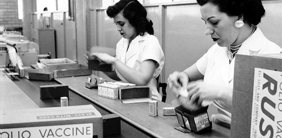black and white photo of two women packing polio vaccinations in the 1950s