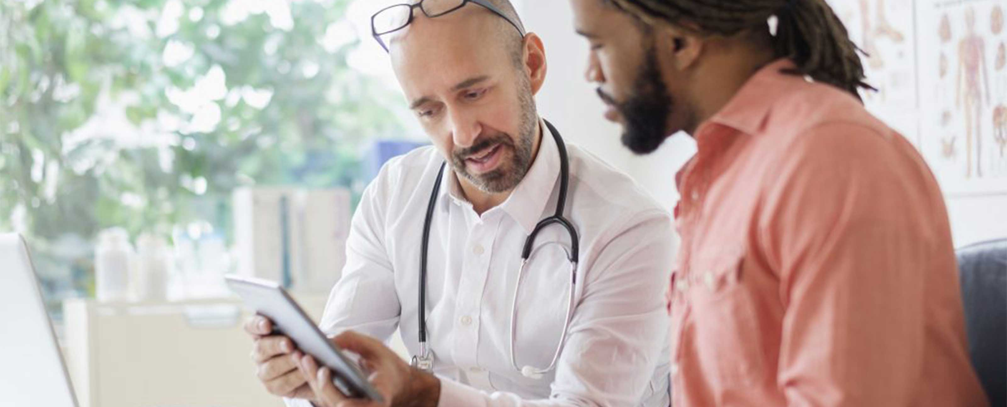 doctor showing a patient something on a tablet device