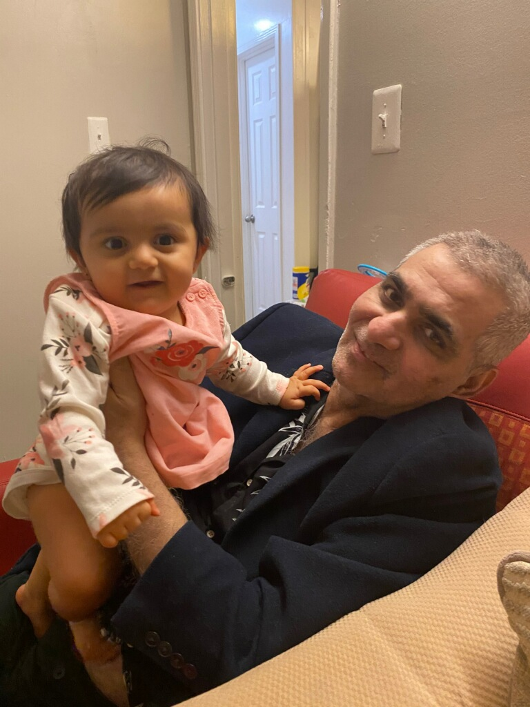"Zubair Khan with his granddaughter, Zarwa, after coming home from treatment. ""The reason I came home is that I was playing with her in my dreams. I knew I had to come back home to see her and play with her,"" he said. Khan lost 60 pounds while battling COVID-19 but is now able to talk and take short walks. (Nargis Mughal)"
