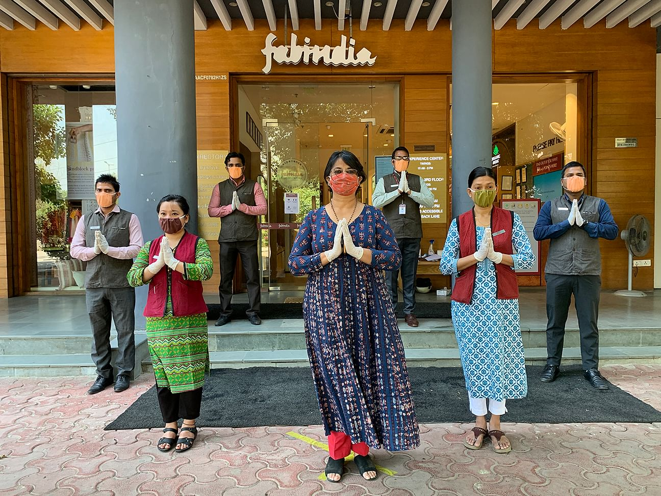 Employees display COVID-19 safety measures as they reopen the Fabindia store in Vasant Kunj, New Delhi. (Fabindia)