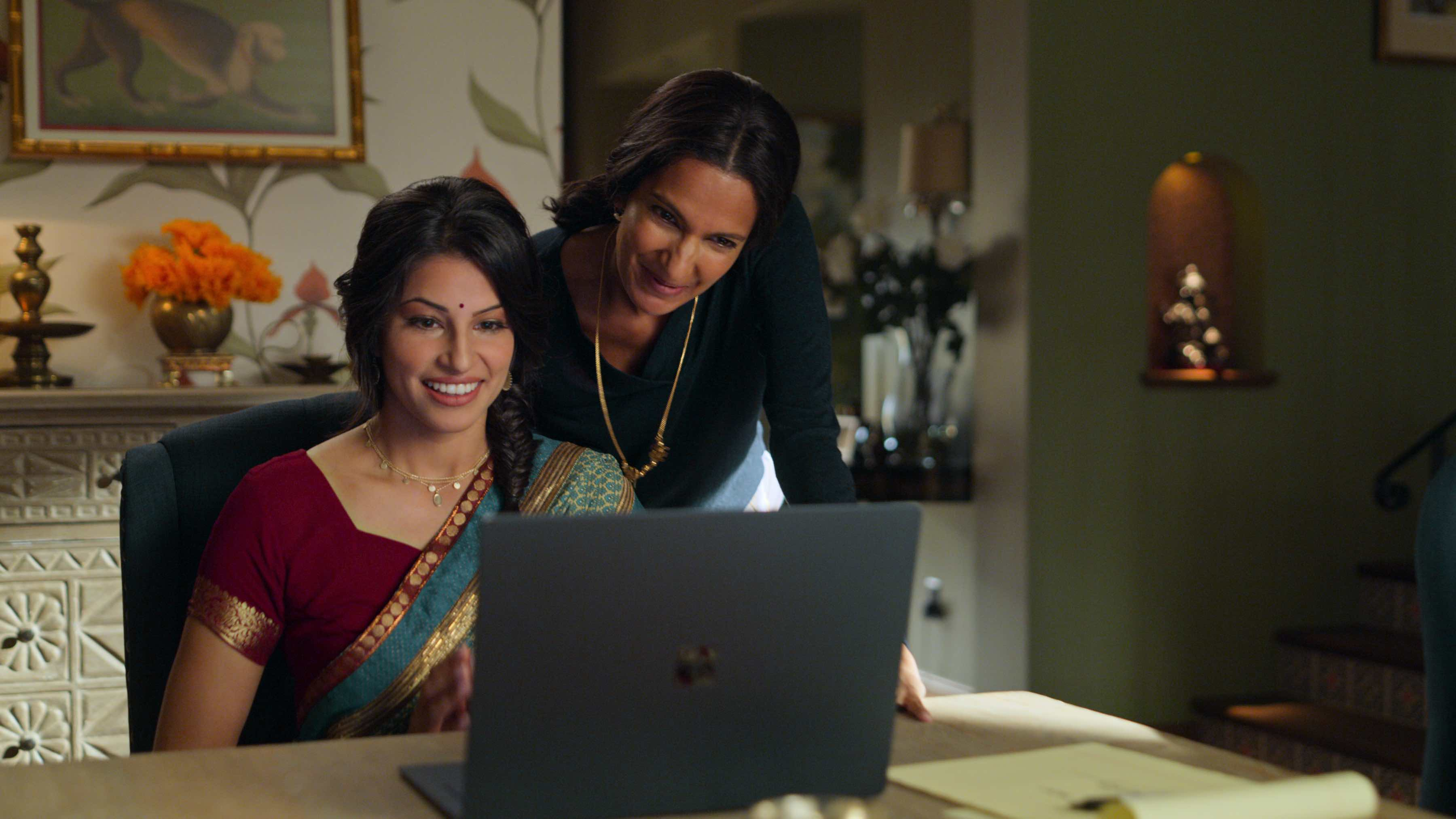 Kamala (Richa Moorjani) and Nalini (Poorna Jagannathan) on a video conference call with Kamala's prospective in-laws (Netflix)