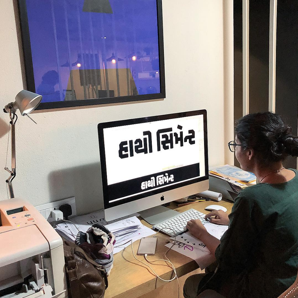 A designer working on a Gujarati typeface. (Indian Type Foundry)