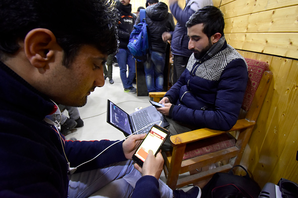 Kashmiris use their devices after authorities restored low-speed mobile internet services in Kashmir in January 2020. (Muzamil Mattoo/NurPhoto via Getty Images)