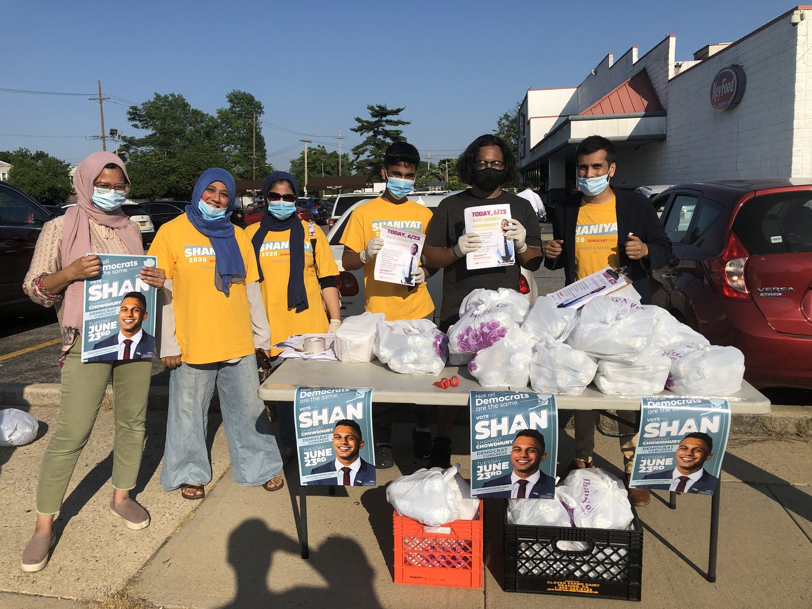 Volunteers for Long Island south Asian congressional candidate Shaniyat Chowdhury hand out gyros outside the legally mandated distance from a polling site in June. Photograph: Raihan Faroqui