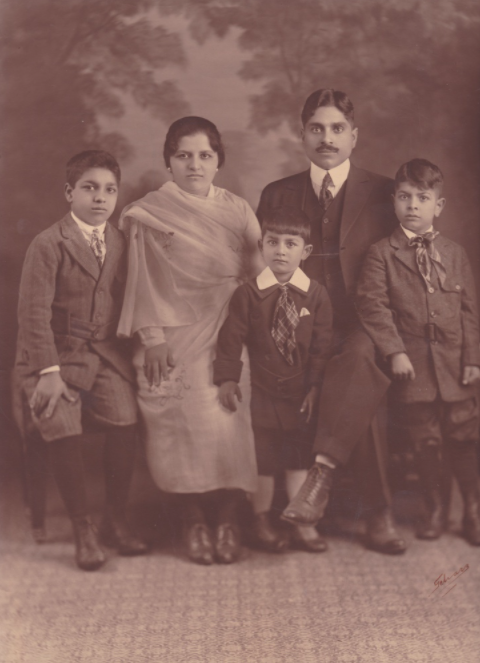 Formal studio portrait of the Bagai family in San Francisco. From left to right: Brij Bagai, Kala Bagai, Ram Bagai, Vaishno Das Bagai, Madan Bagai.