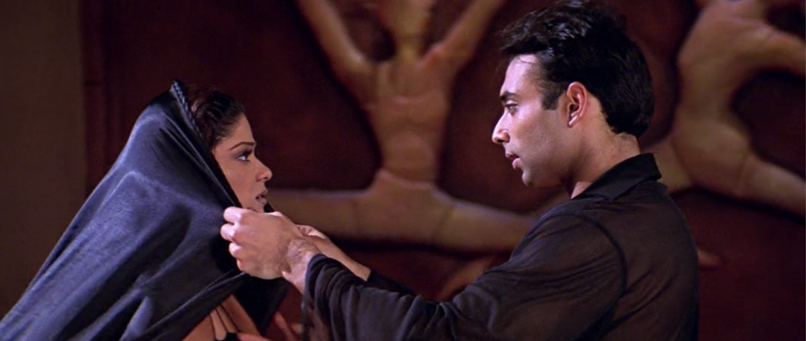 "Eventually, Uday Chopra convinces Shamitha Shetty to dress more ""modestly."" (Mohabbatein)"