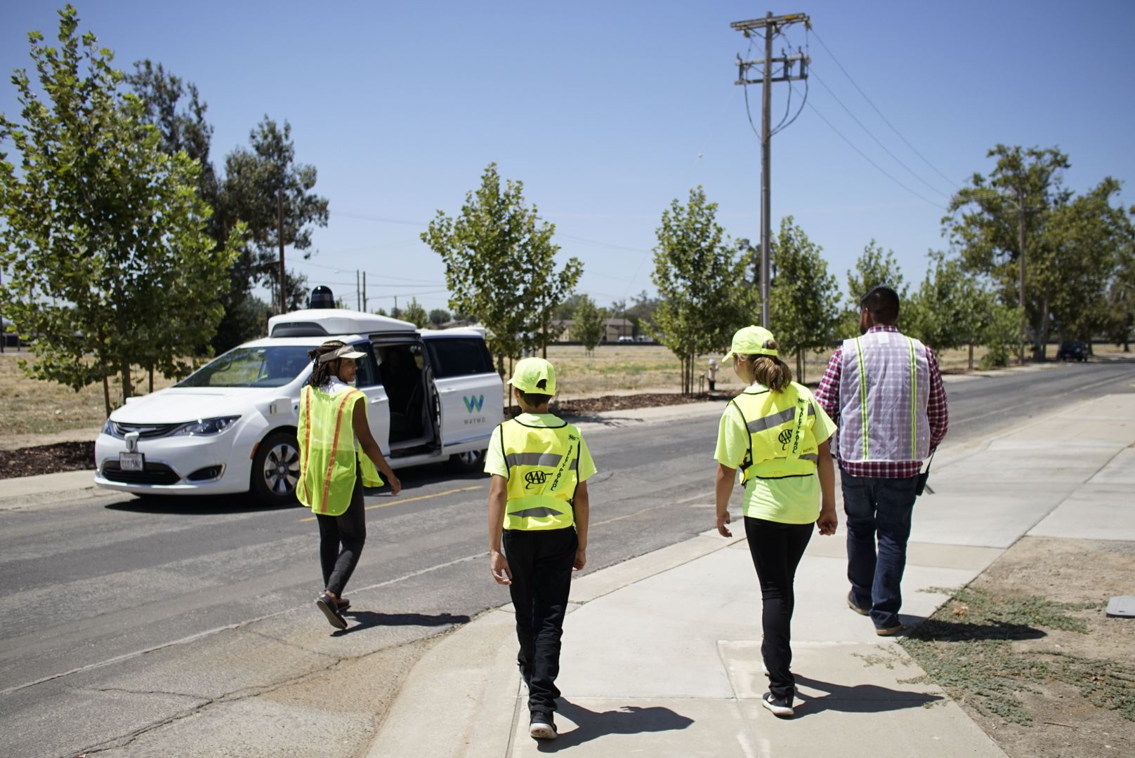 AAA School Safety Patrol students go for a ride in a Waymo