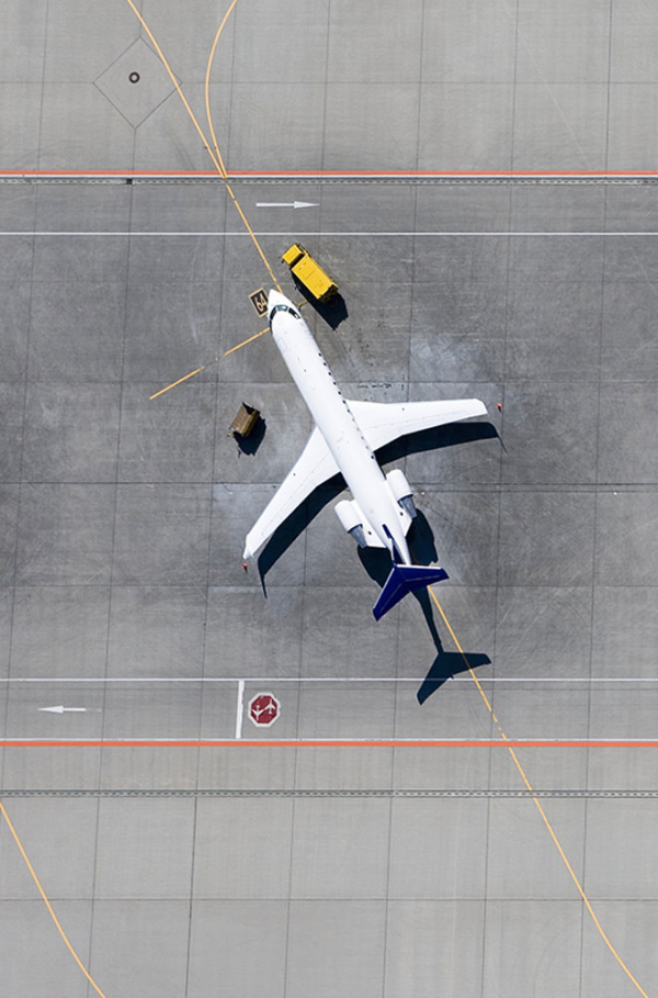 Overhead of airplane on a tarmac.