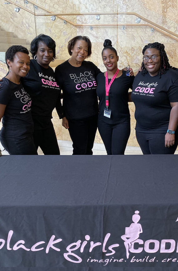 Five people smiling at a girls who code event