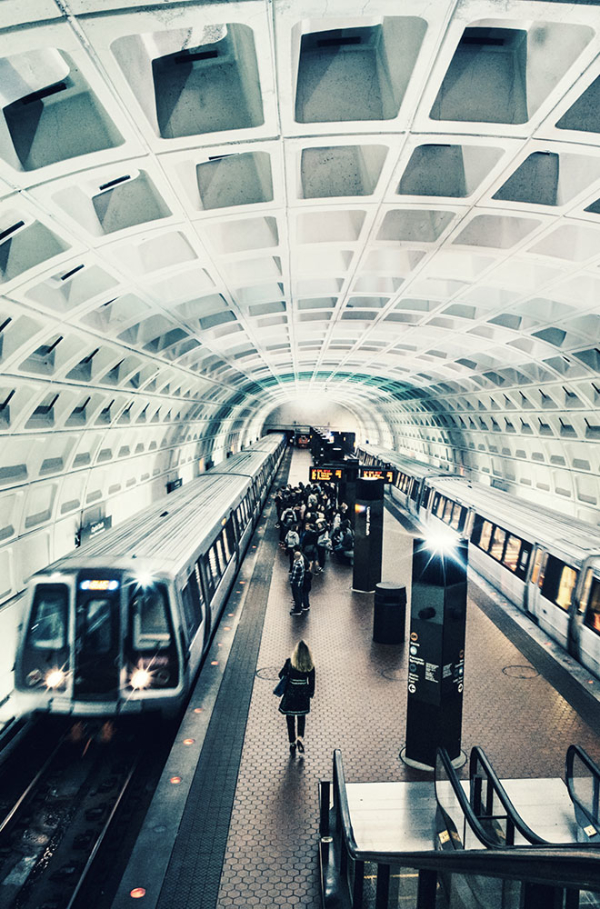 Train arriving in a Washington D.C. metro station.