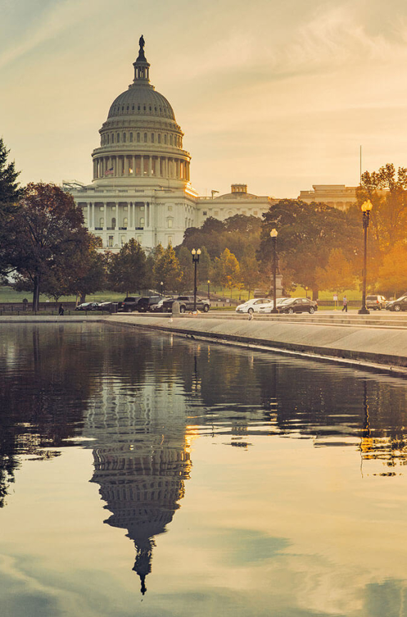 U.S. Capitol in dusk with a reflecting pool