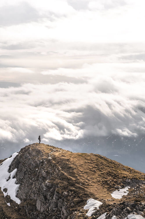 person standing on top of a mountain