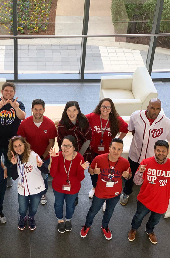 People cheering on on the Washington Nationals at the GDIT office