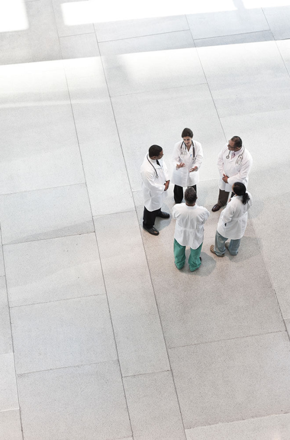 group of doctors standing in a circle