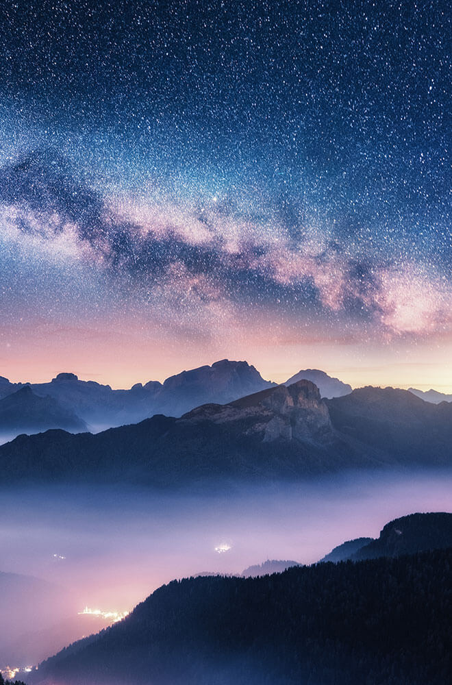 Mountains and sky with stars at dusk