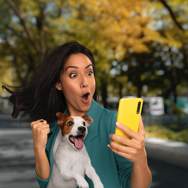 Girl who is excited and looking at her phone