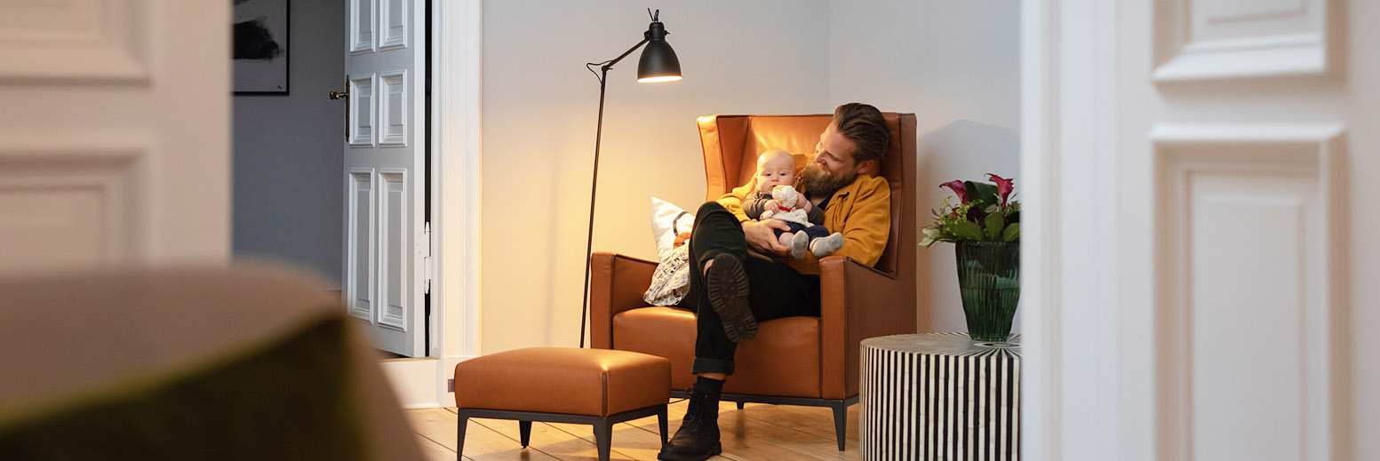 Man with child in chair