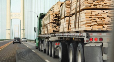 Image of a truck transporting cargo over a bridge