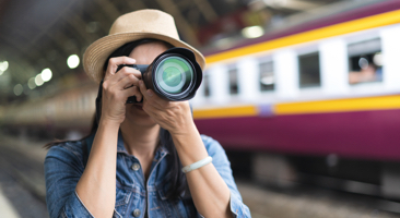 Image of photographer taking a picture at a train station