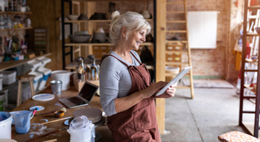 Woman in an art studio sketching on a pad