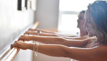 women working out in a barre class