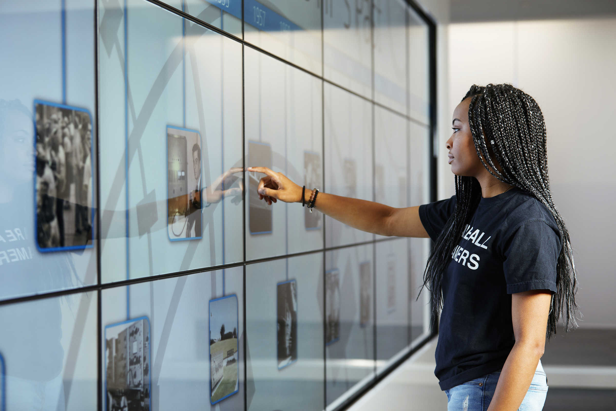 Young woman touching an interactive wall