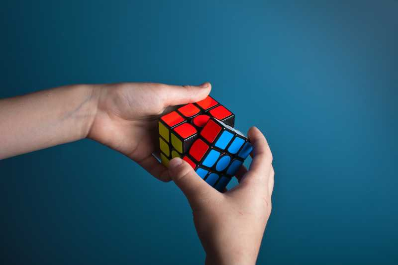 A close up of a Rubik's cube being figured out
