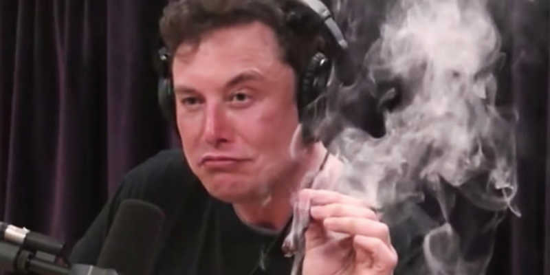 Elon musk smoking a funky cigarette