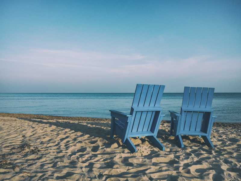 Two chairs on a serene beach