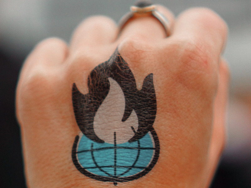 Fist with flame tattoo