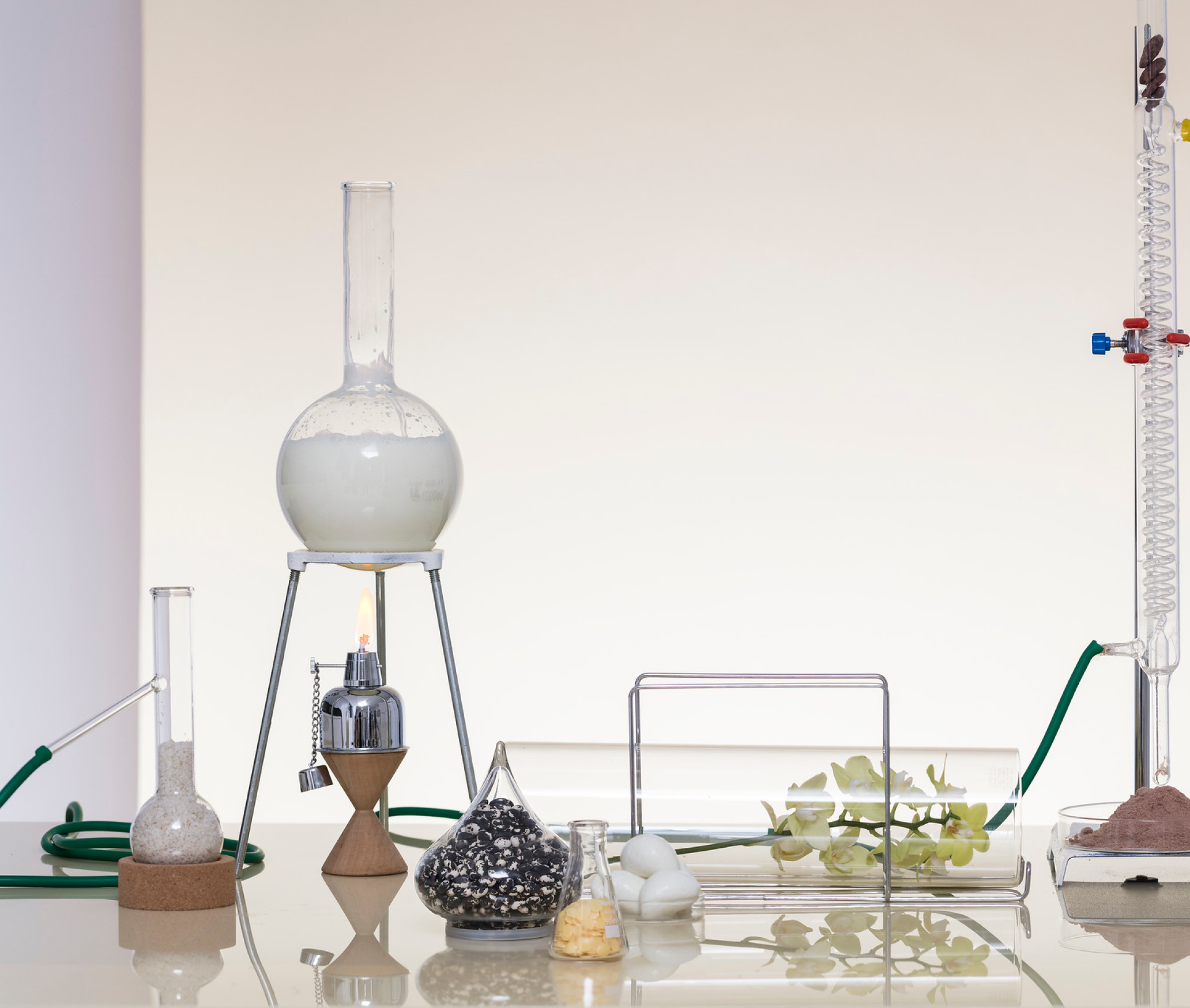 Photo of chemistry equipment and ingredients on a reflective surface