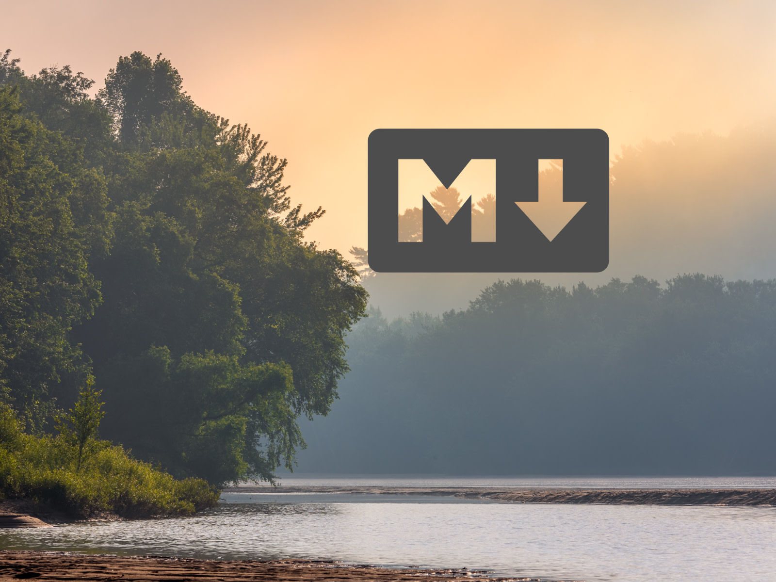 Markdown Logo in dark grey in front of a background of the Yukon River with slight fog in the early morning hours.
