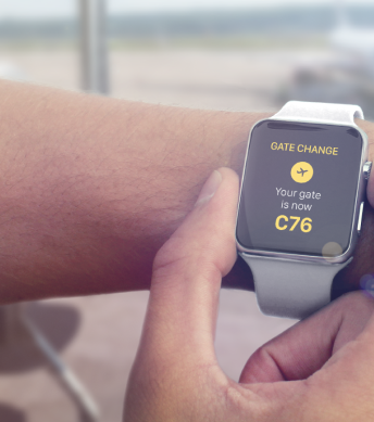 a smartwatch that shows an airport gate change