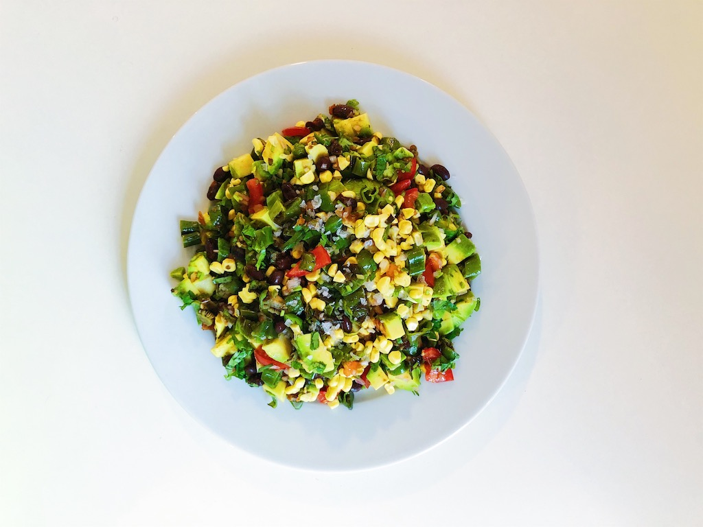 Black bean, corn, and roasted shishito pepper salad