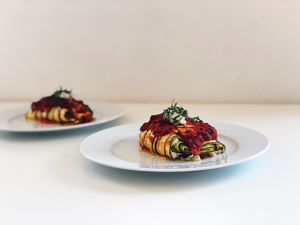 Zucchini rollups with almond ricotta baked in tomato sauce