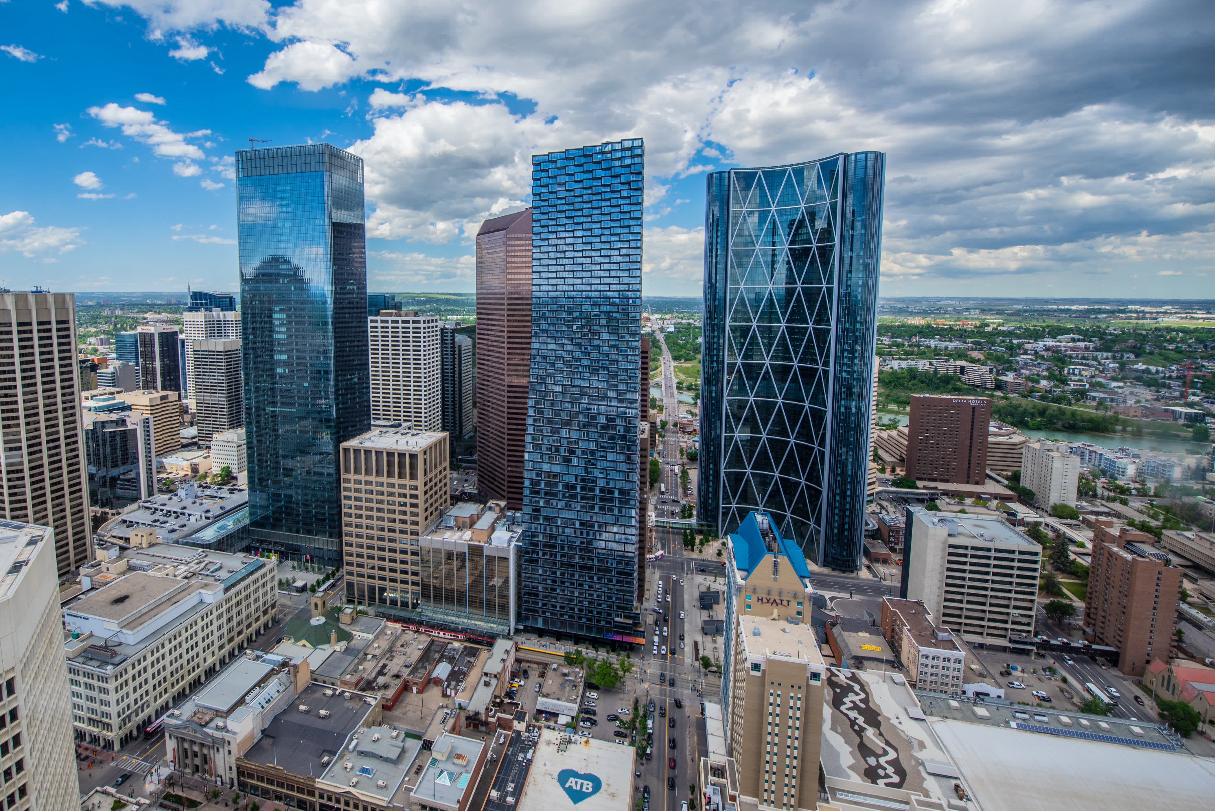 An aerial shot of buildings in Calgary, featuring the new TELUS Sky