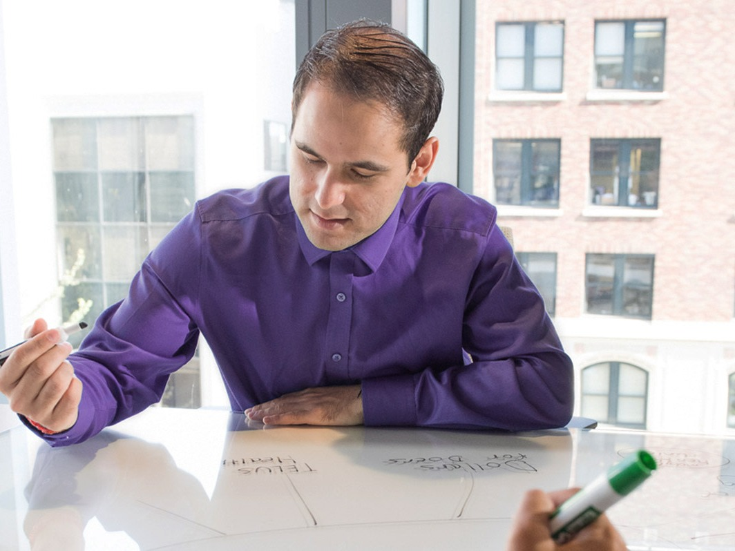 A D&I Council team member seated at a conference table