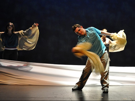 Two dancers using sheets as props in their dance